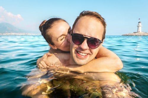 Couple taking selfie in water
