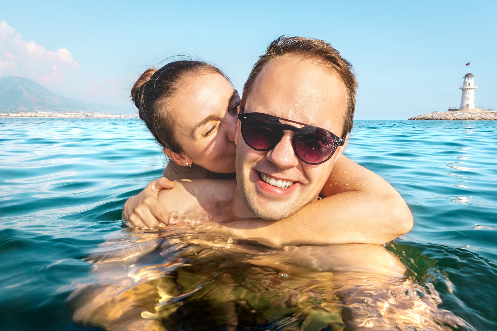 Couple taking selfie in water