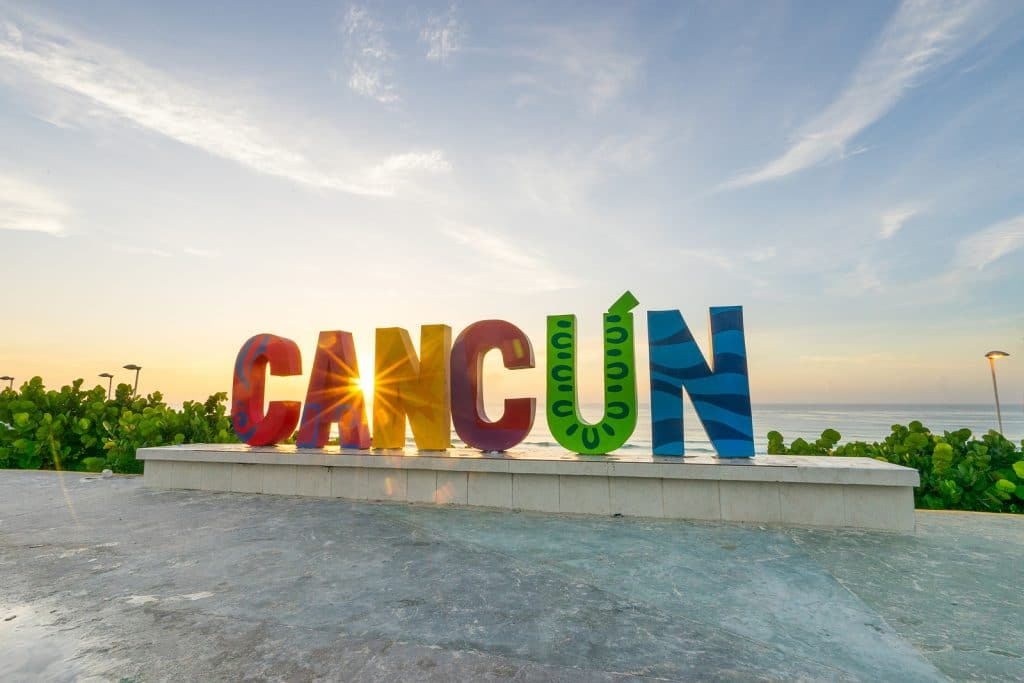 The Cancun sign at sunrise at Playa Delfines